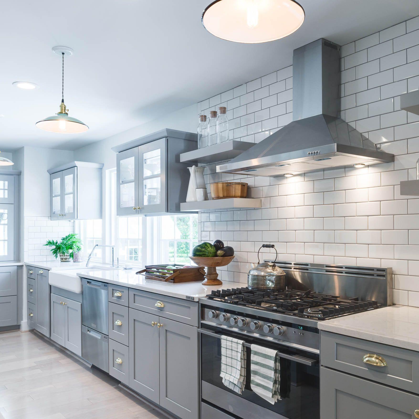 gorgeous gray this modern farmhouse kitchen boasts crisp white subway tile with grout to match on kitchen id=42469