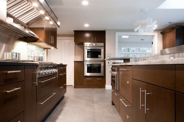 Brown Slab Cabinets Light Counters Grey Tile Floor Kitchen
