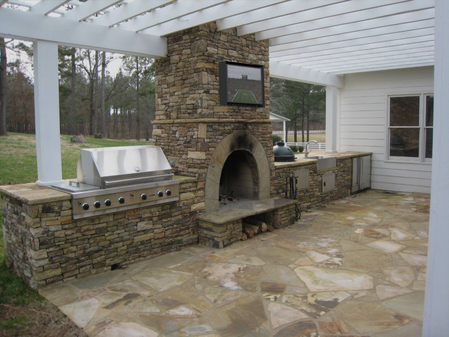 Rain Case Tv Entertainment For Your Great Outdoors Outdoor Fireplace Designs Diy Outdoor Fireplace Outdoor Fireplace Kits