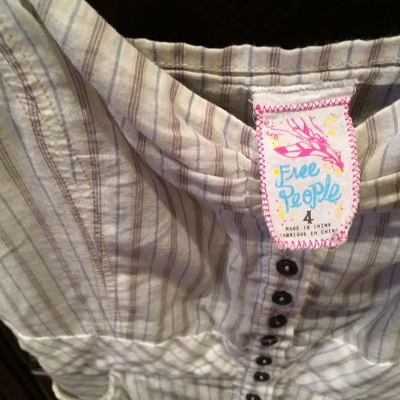 Free people top Button down tank. Good condition. Side pockets Free People Tops