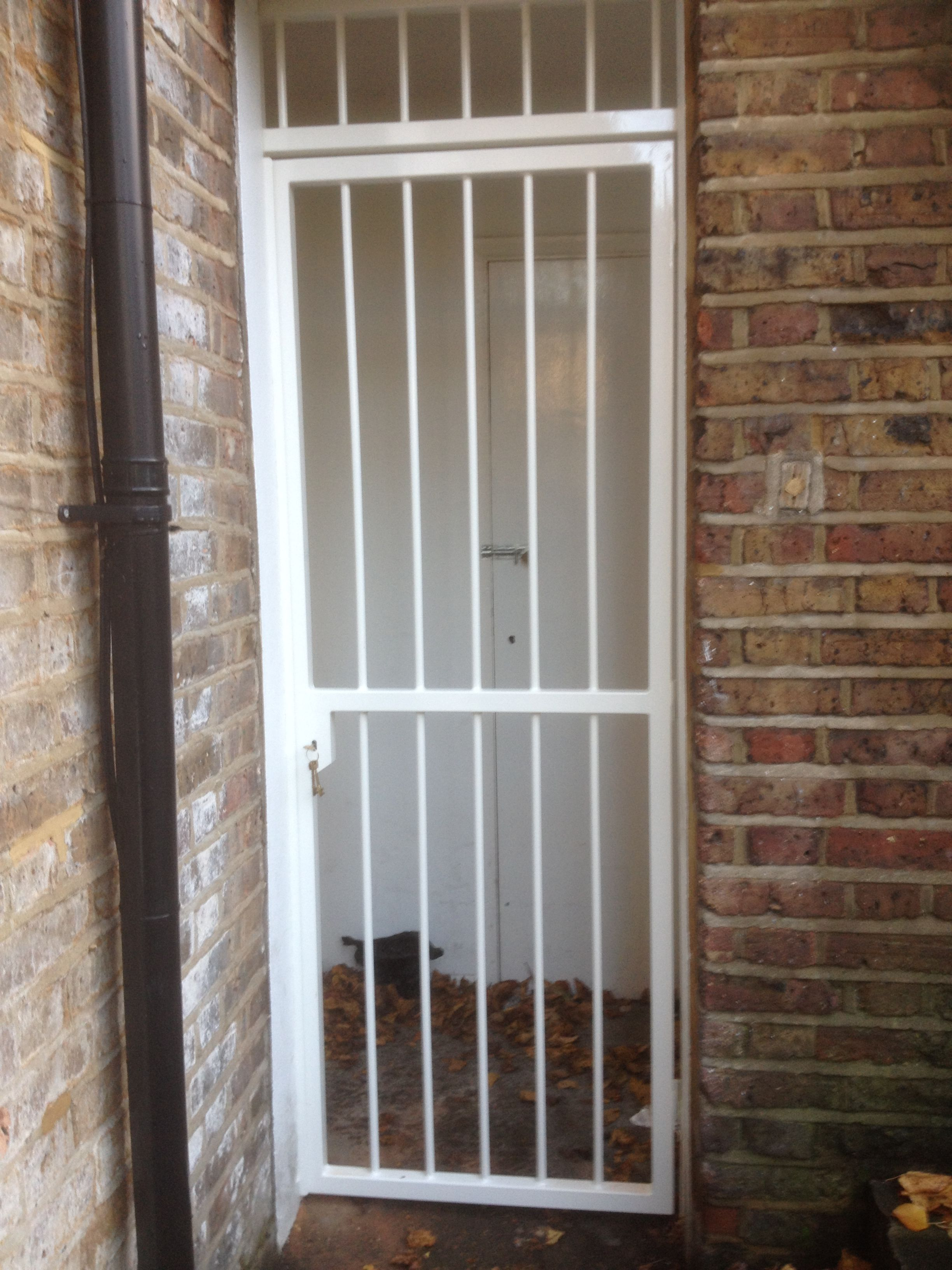 rsg3000 security door gates fitted to the back opening of a ground flat in central london