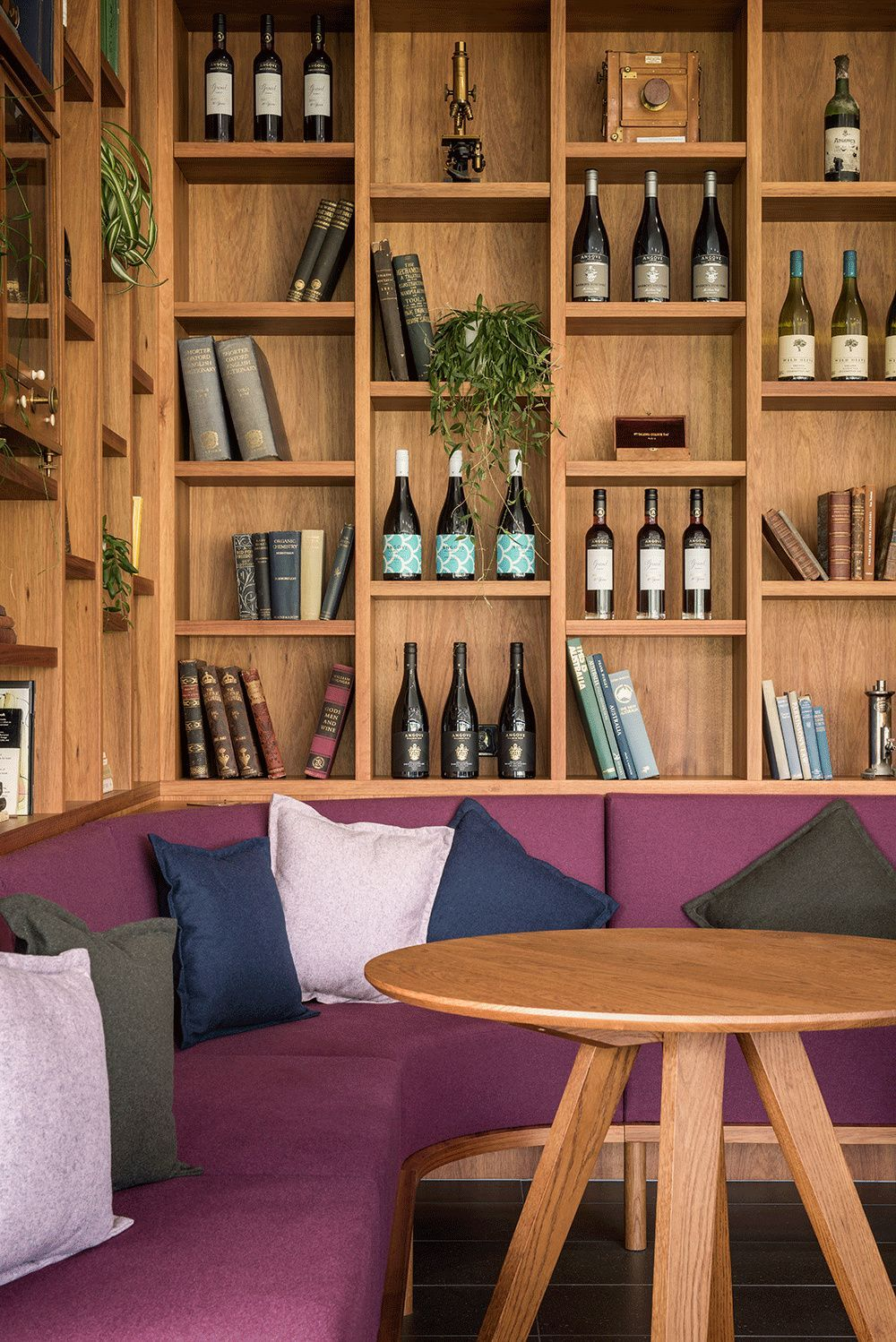 Angrove Cellar Door + Builtin Storage + Coffee Shop Design + L-Shape Sofa + Builtin Bench + Winery Design + Book Shelves + Throw Pillows | Design by Georgie Shepherd Interior Designer