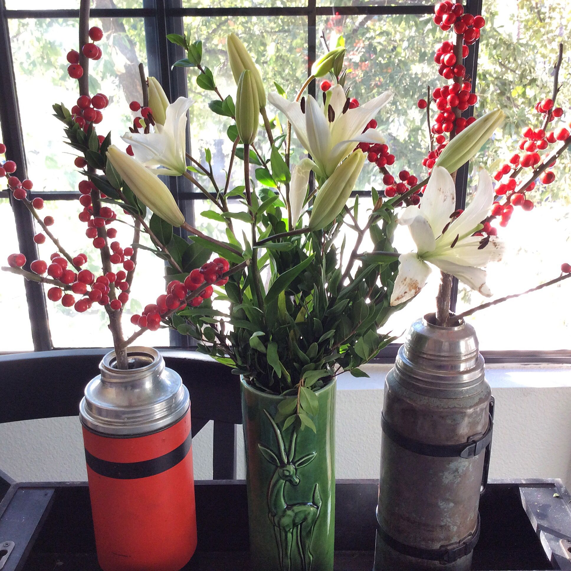 Vintage thermoses & vase with fresh flowers from Trader Joes.