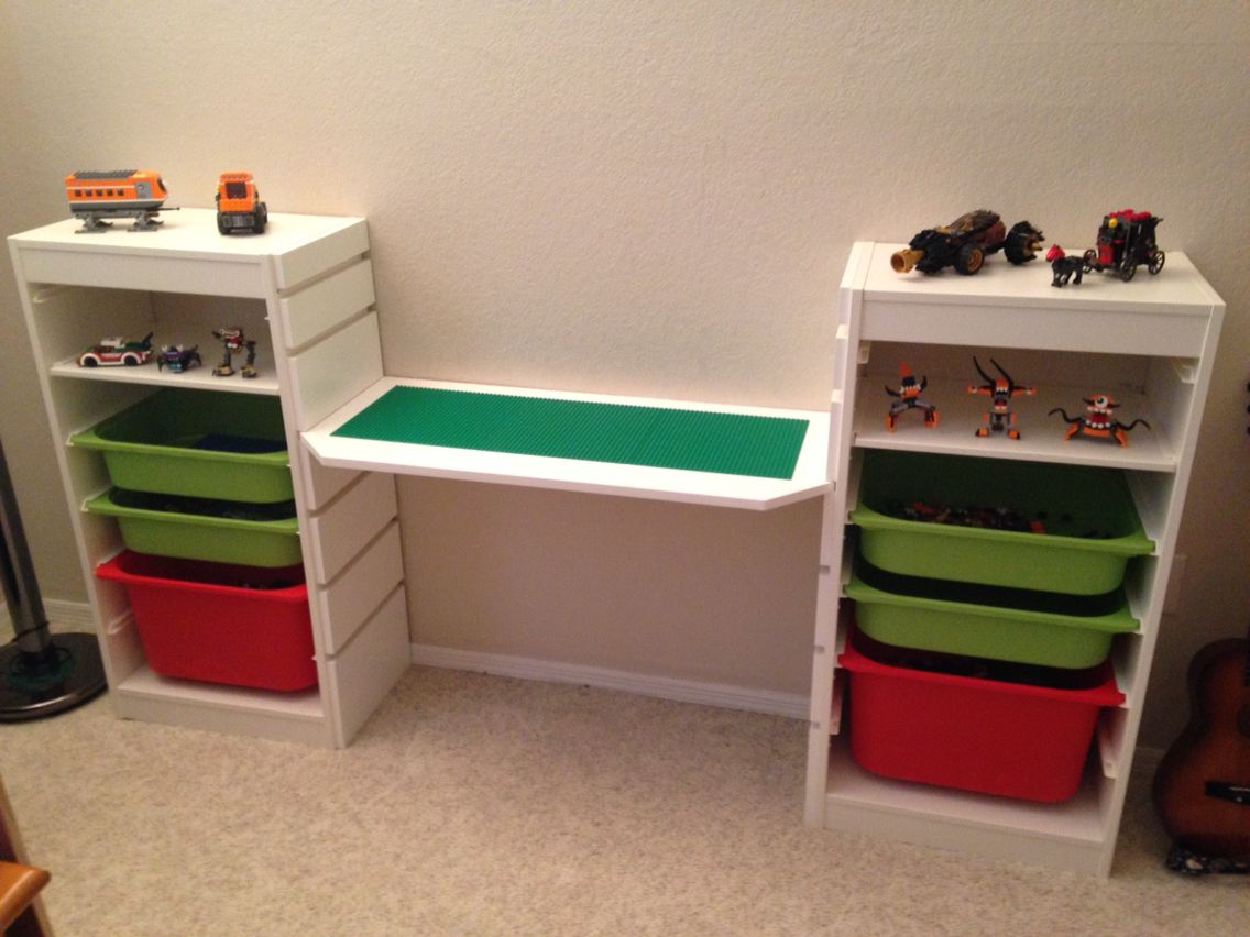 lego desk used ikea trofast for the ends and had my dad make the middle plank and make notches. Black Bedroom Furniture Sets. Home Design Ideas