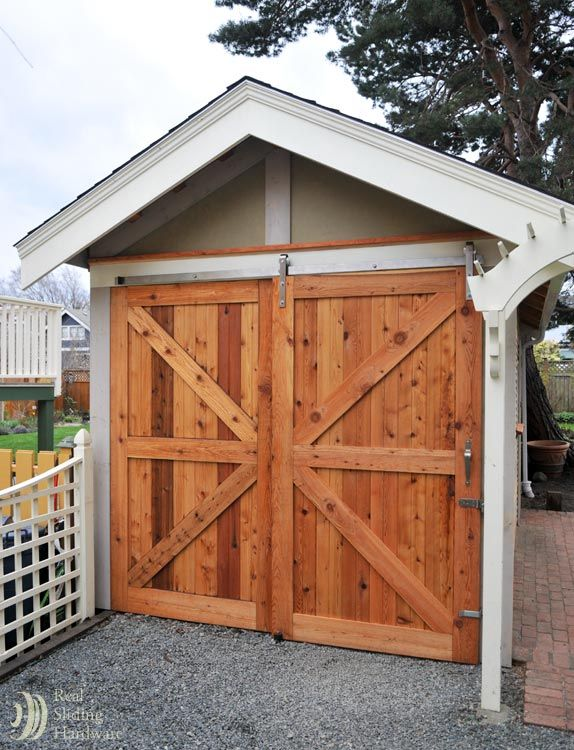Large Barn Doors On An Outdoor Shed Right Door Slides Over Fixed Door Exterior Barn Doors Barn Door Garage Double Barn Doors