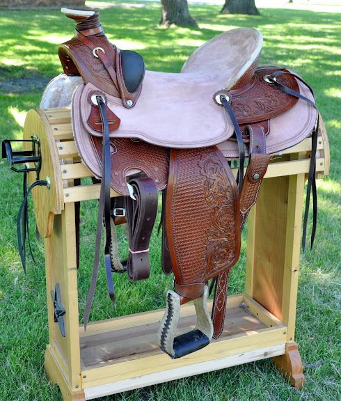 """17"""" Used Western Wade A Fork Buckaroo Roper Saddle // I consider a saddle both a very important tool and a work of art. This one looks very nice.    This is listed as used but that could only because of the stains on the rear of the seat. I can tell this saddle has very likely never been used. It's not a great quality saddle if you can buy it cheap. But right now it would serve as a interim saddle until I can buy a good one again."""