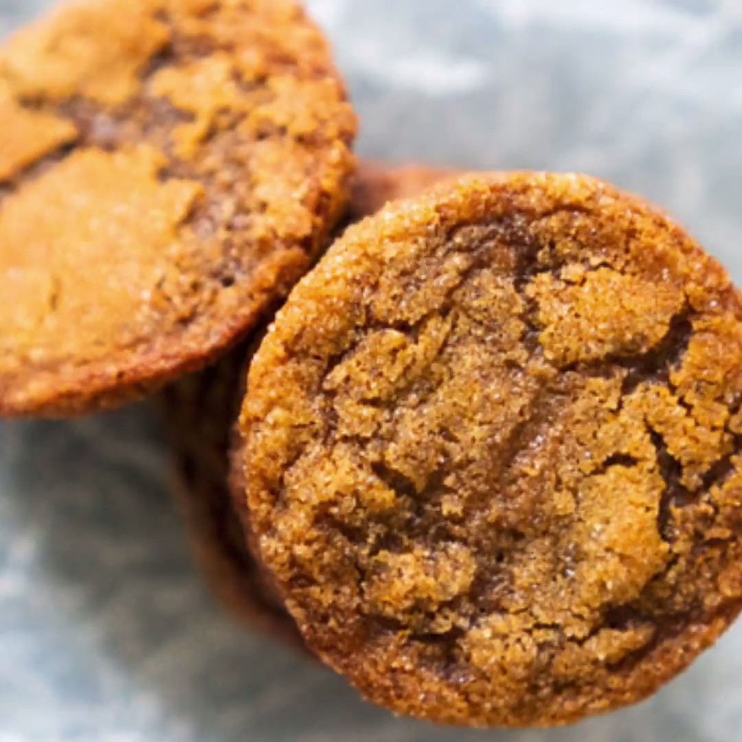 The perfect gingersnap cookie recipe, these old-fashioned ginger snaps are crisp on the outside and chewy on the inside and rolled in sugar! They're a perfect holiday baking recipe!