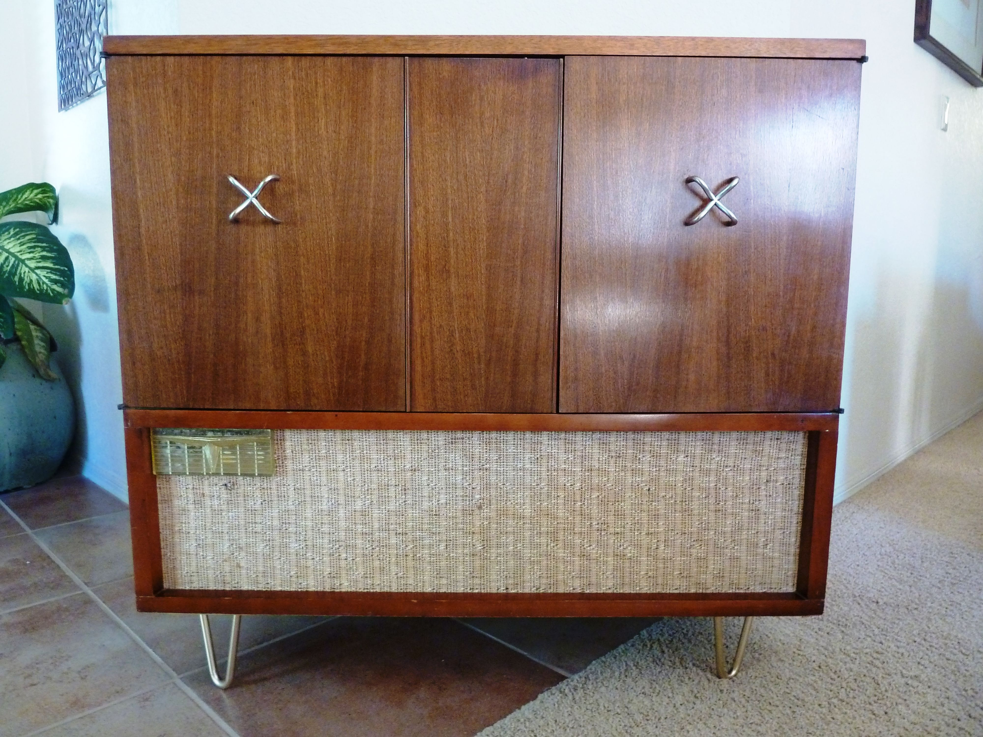The doors on this 1950's vintage cabinet concealed a black and ...