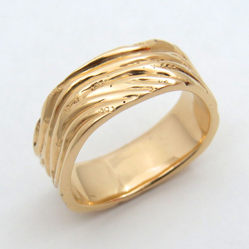 Hand engraved rose gold kelp ring dnh sustainable jewelers