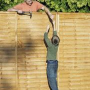 How To Attach A Wooden Privacy Fence To A Cinder Block Wall Hunker Cinder Block Walls Front Yard Fence Concrete Block Walls