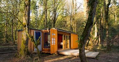 orange shipping container cabin using a 20 and 40 foot contaner
