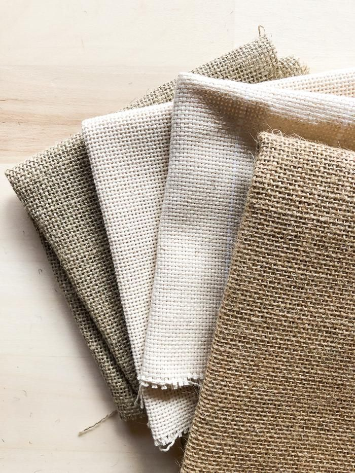 The four basic punch needle foundation fabrics are burlap, Monks cloth, rug warp and linen. Each fabric has its own specialty and each are good for certain projects. Punch needle pillows, benches and artwork each work well with a certain type of fabric.