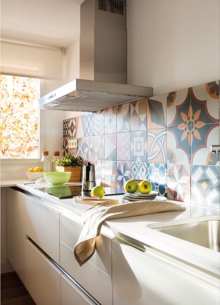 The bright kitchen is separated from the living spaces but feels