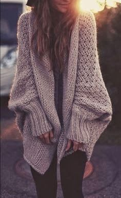 Adorable ladies cardigan which is over sized fashion for snow periods