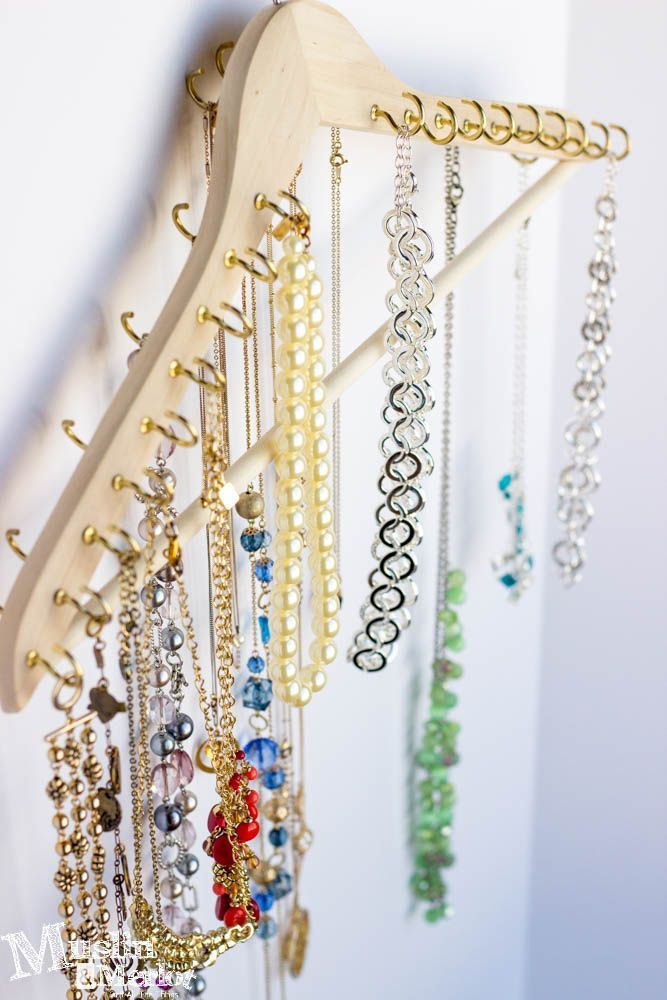 Jewelry organizer made from a wooden hanger and pack of 78 cup