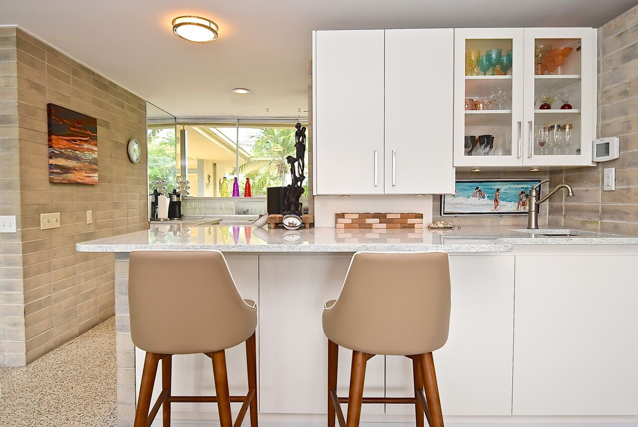 From The Giant Sliding Glass Door To The Terrazzo Floor And Modern Geometric Design This Home Is The Perfect Exam Terrazzo Flooring Florida Design Countertops