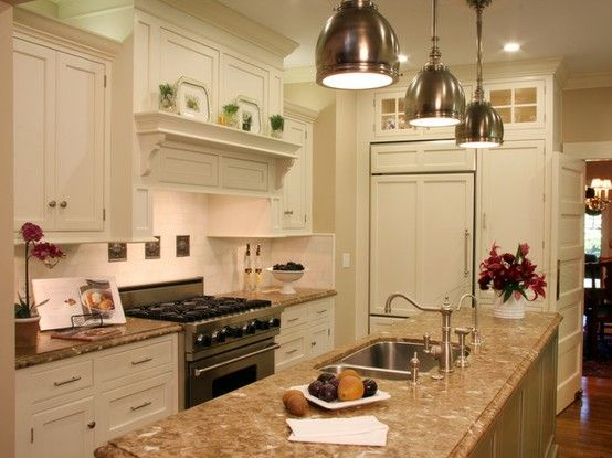 nice like the color, lighting, granite, paneling on refrigerator doors and faux windows above the refrigerator!