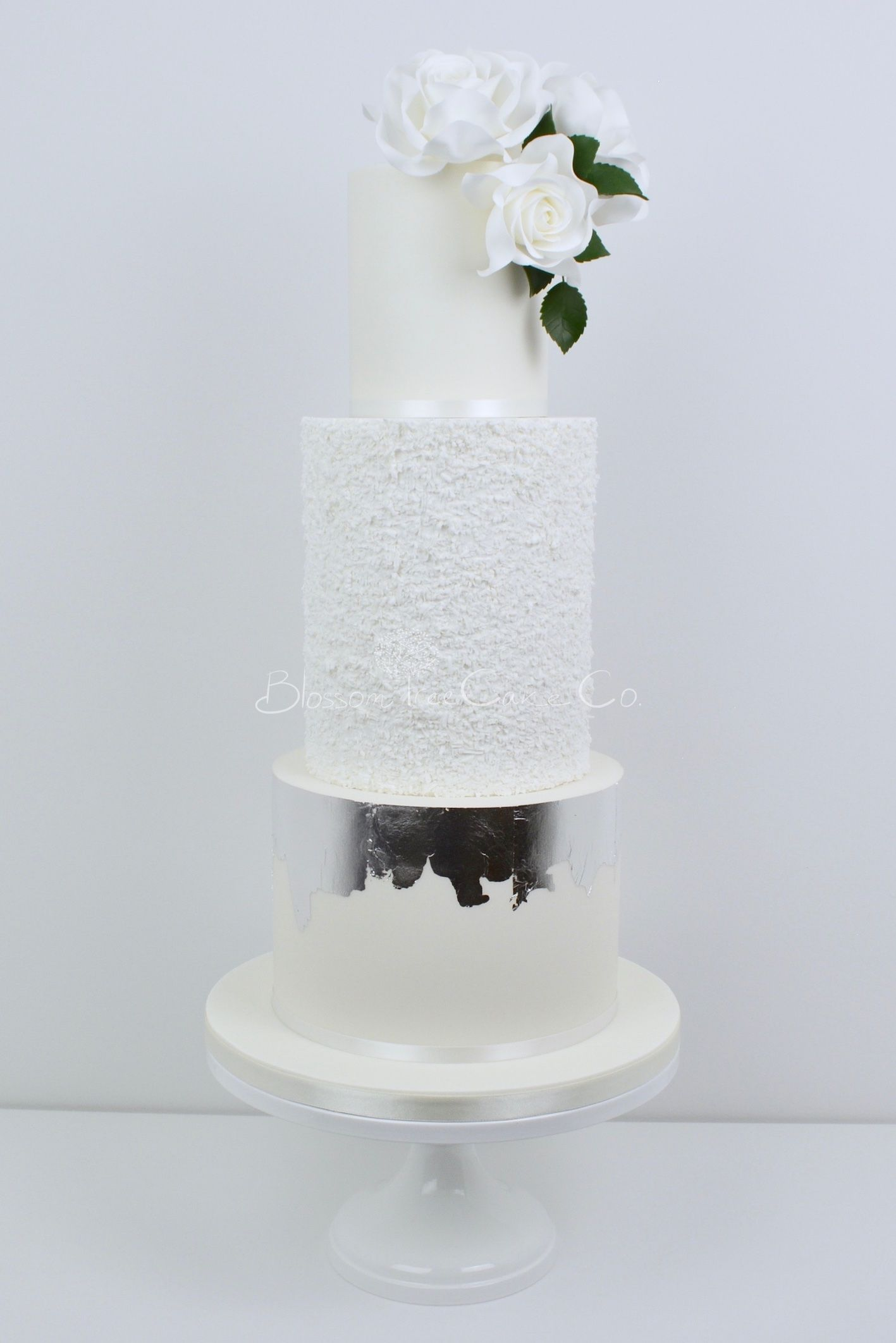 White roses and silver wedding cake by blossom tree cake company