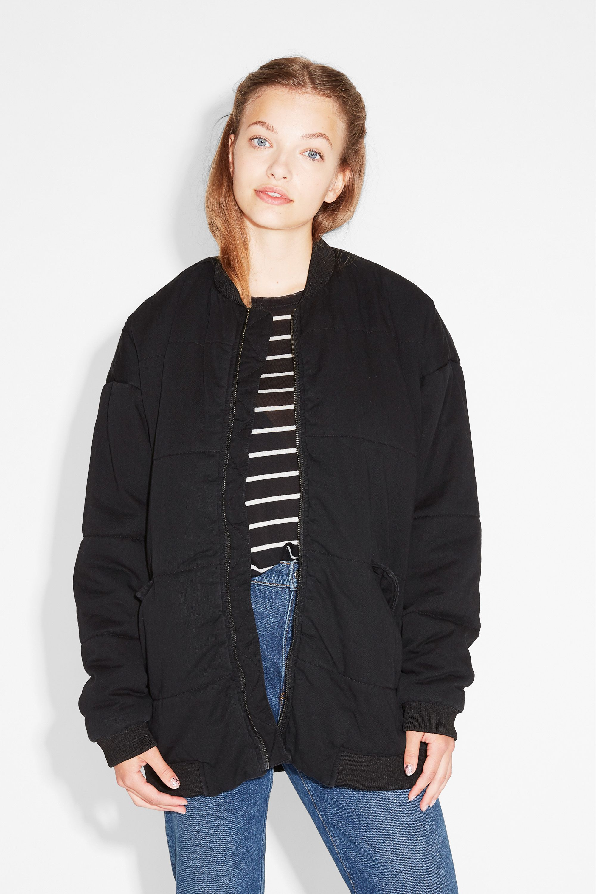 A padded bomber jacket in black denim, long in length and totally badass in…