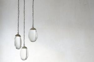 Ochre. Exquisitely beautiful Celestial Pebble pendant lights from Ochre – solid glass drops with integrated LED lighting. Is it lighting or is it artwork - we think it is both.  www.ochre.net