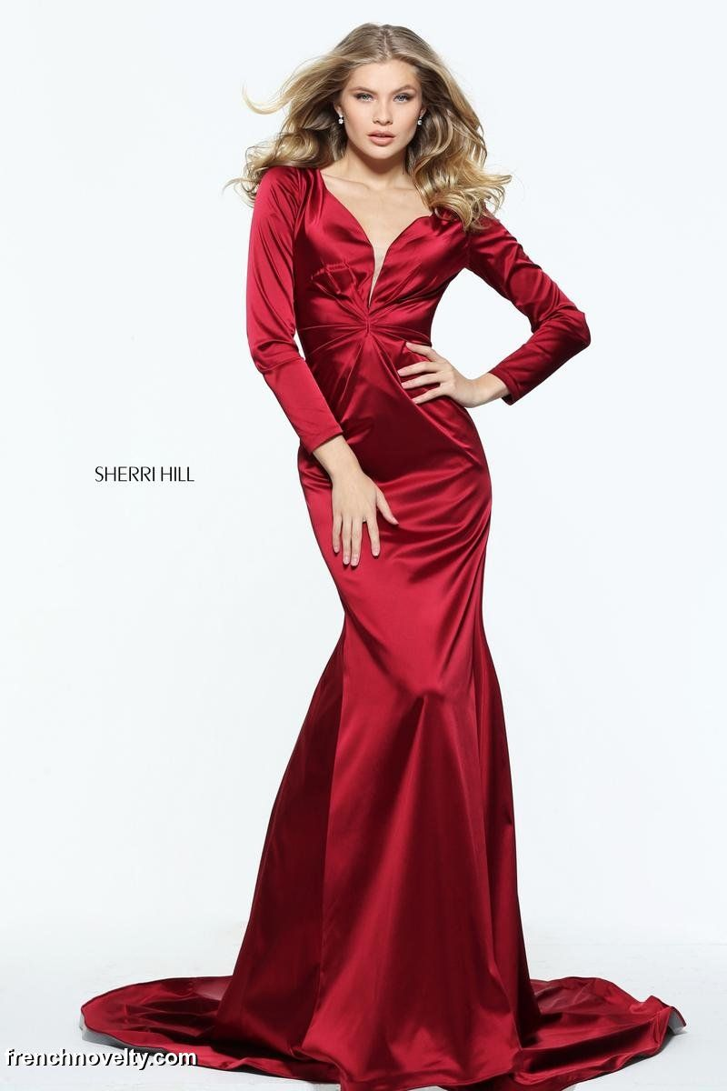 Sherri hill is a long sleeved evening gown with a deepv
