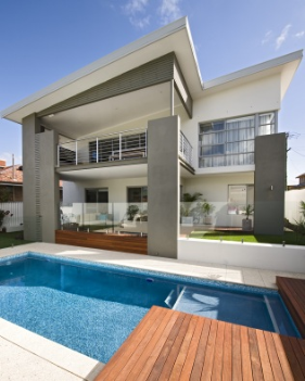 Pool with Skillion - The natural contrast between this stunning pool with floating timber deck and the hardscape surrounds draws this backyard together. The picture is complete with the striking skillion roof behind. For more home ideas: http://www.residentialattitudes.com.au/my-portfolio/images