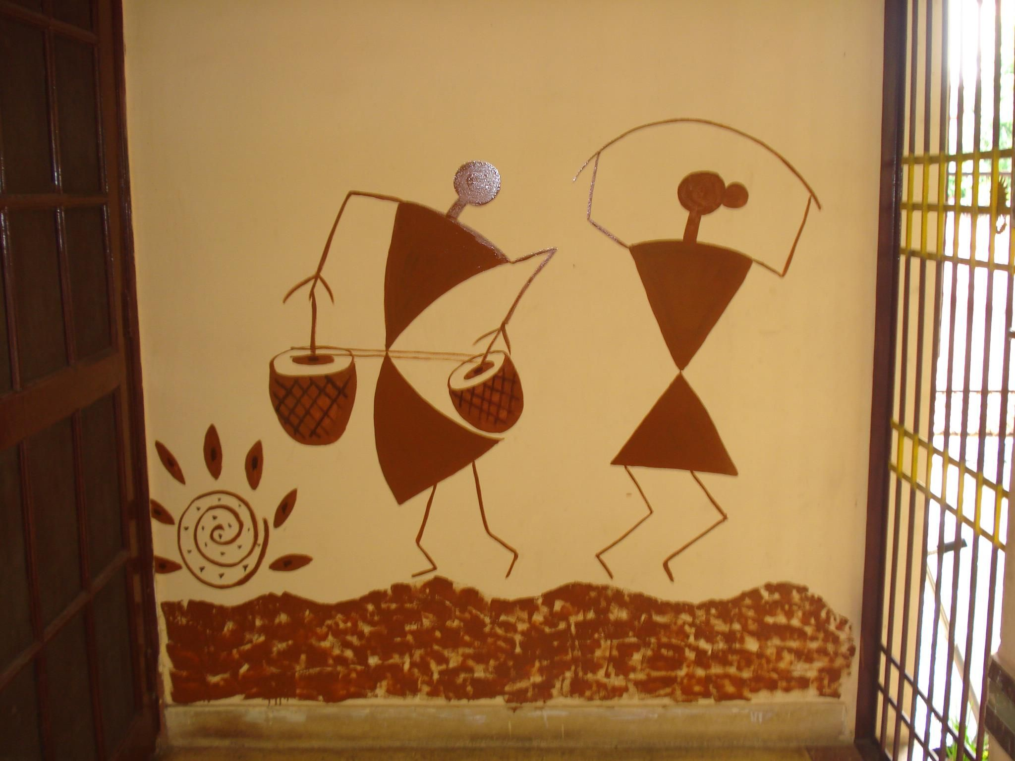 Warli art on a wall near a door entrance fanart worli painting