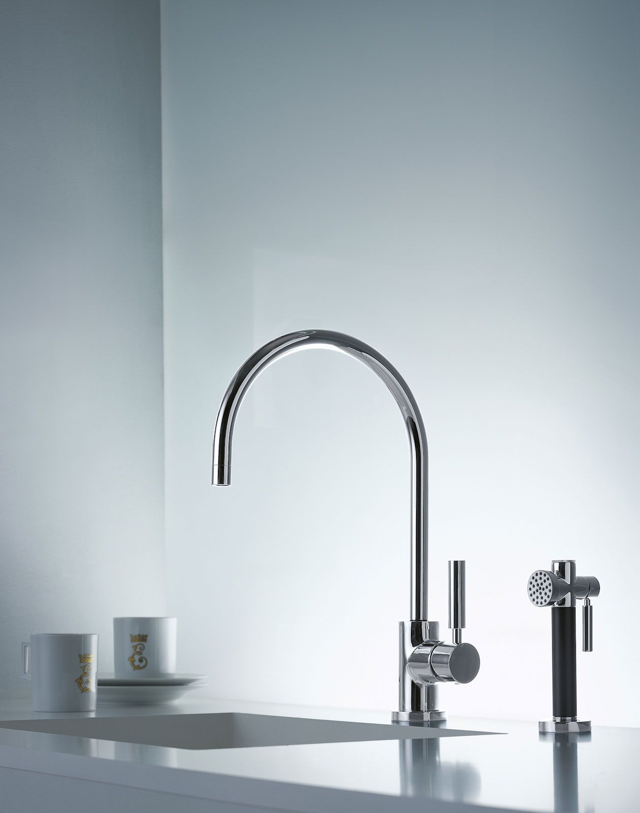 Dornbracht's simple kitchen faucet with hand spray / Tara Classic Collection