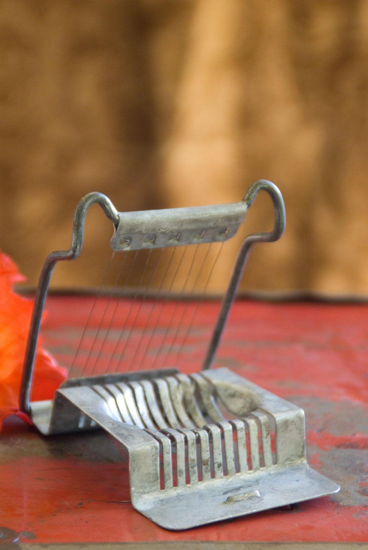 Vintage hard-boiled egg slicer kitchen accessory for your slicing desires. $6.00, via Etsy.