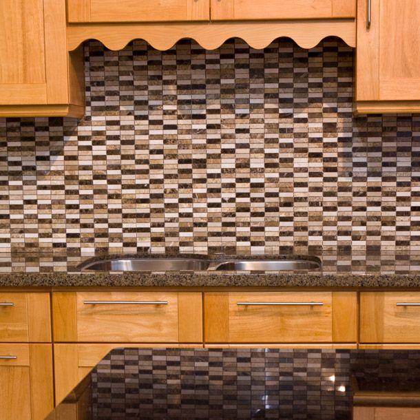 Mix Of Polished Botticino Emperador Light And Dark Marble Tile Used As A Kitchen Backsplash