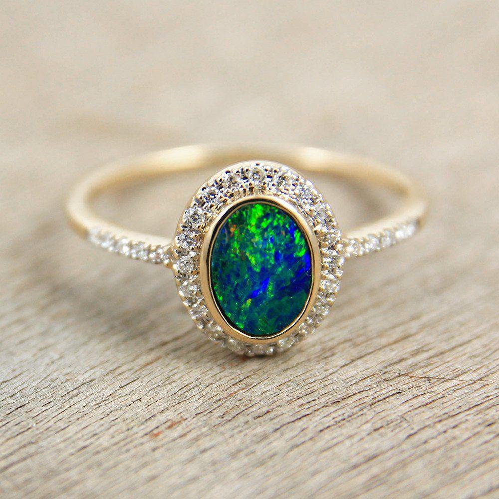 Distinctive and elegant opal & diamond ring in 14K or 18K
