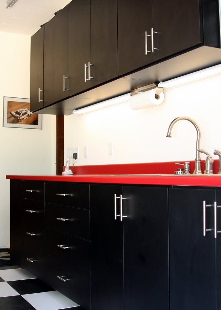black melamine garage cabinets with red formica countervalet