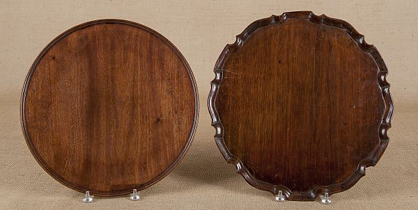 "Pook & Pook. October 11th & 12th 2013. Lot 749.  Estimated: $300 - $500.   Realized Price: $1126.   George III mahogany piecrust tray, ca. 1770,17 1/2"" dia., together with a Queen Anne mahogany tray, 17"" dia."