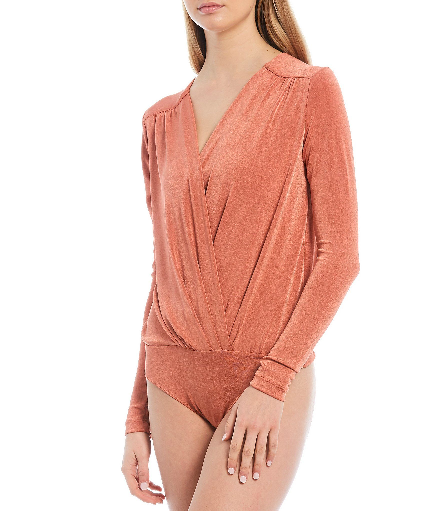 From Free People, this bodysuit features:plunging v-neckline long sleevespleating detail snap closureapprox. 31.25