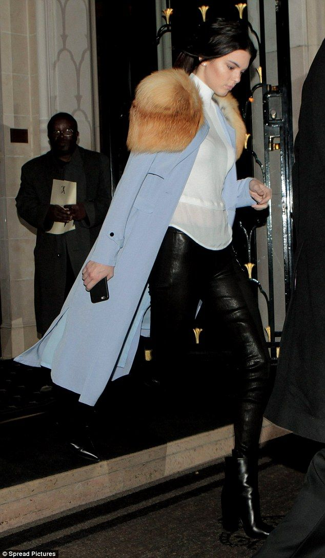 f07a95331b7 Hell for leather  Kendall Jenner leaves her Paris hotel on Sunday evening  in a pair of leather trousers and baby blue coat