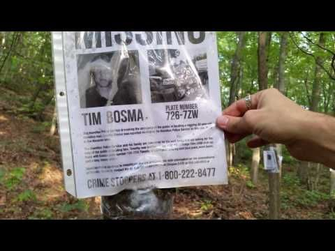 Man finds missing posters hanging from trees in the woods - missing persons posters