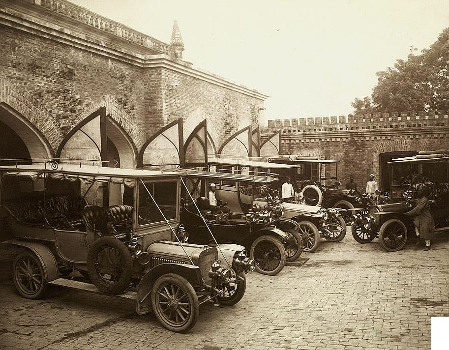 Photograph of the state cars in a garage at Rampur in