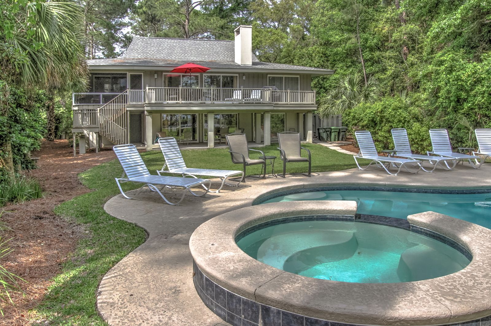 This enchanting 2 story ocean view Sea Pines home with a