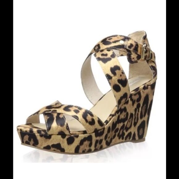 Nude Stallion Leopard Platform Wedge Sandal Nude Stallion leopard print leather wedge platform sandal.  Size 8 or 9 medium.  New with box.  A thick platform and solid wedge lend a boost to this strappy, show-stopping design.  Leather upper and lining; man made sole.  No trades. Nude Shoes