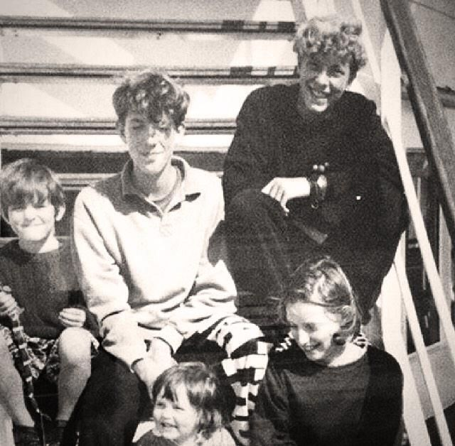 Young Chris with his little siblings. (The oldest, cutest one is Christopher).