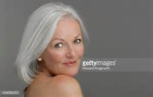 Mature Glamorous Woman Smiling Stock Photo | Getty Images
