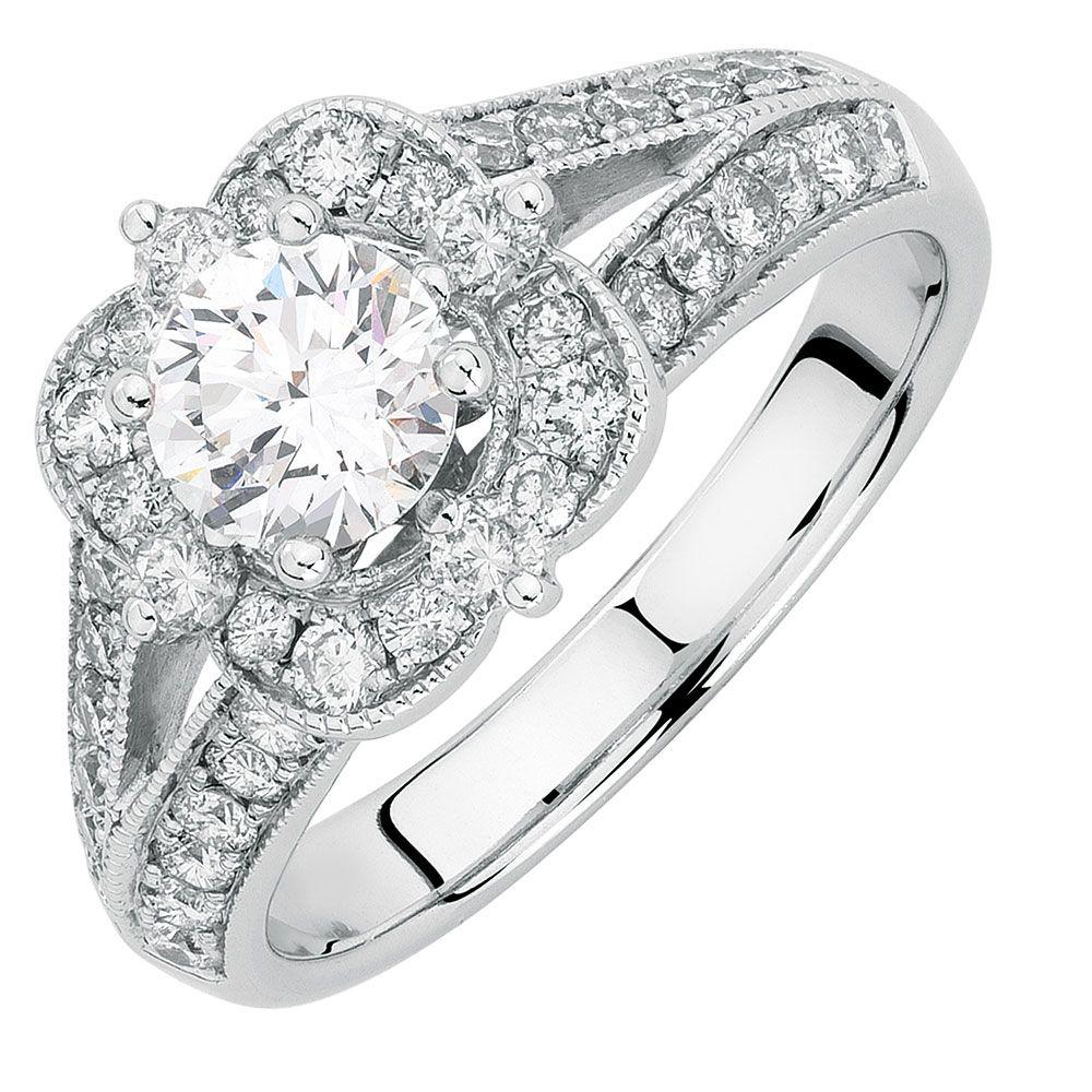 This beautiful carat total weight diamond engagement ring