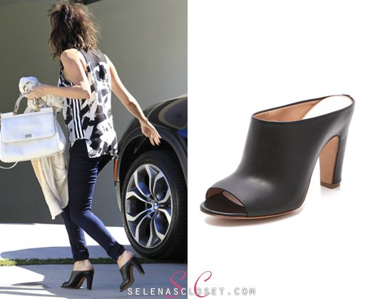 Selena Gomez got papped while out with friends in LA yesterday and we couldn't help but notice her shoe game. She wore Maison Martin Margiela Curved Heel Mules in color black. You can find these shoes on shopbop.com on SALE for $577.50. (marked down from $825)  Buy them HERE  Thanks belieberskidrauhl!  She's also carrying her Dolce & Gabbana bag and Free People cardigan. We're looking for the rest of her outfit.