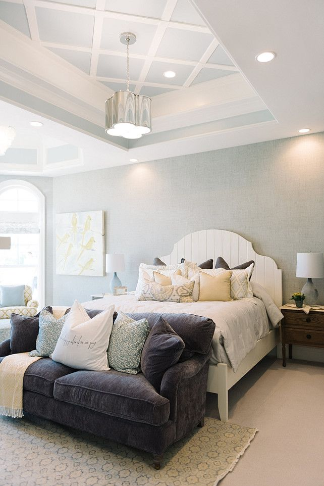 The Master Bedroom Features White Bed Tray Ceiling And Pillows With Fabrics By Sarah Richardson