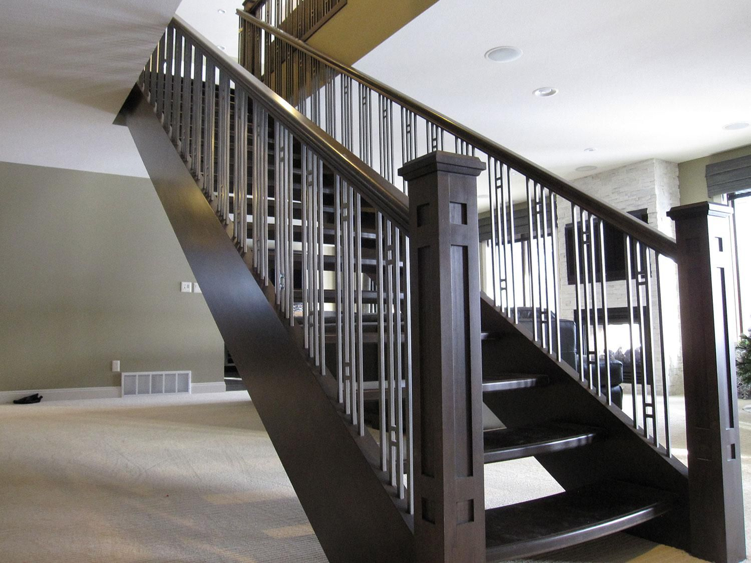 Accent your stairs using metal stair railing newels and for Interior iron railing designs