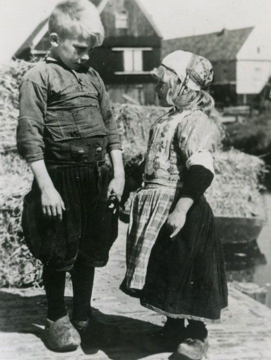 Young dutch boy and girl in traditional clothes    Young dutch boy and girl in traditional clothes. Photo taken in Marken (Holland) in 1947 by Alison Dunn.   Note the wooden shoes....