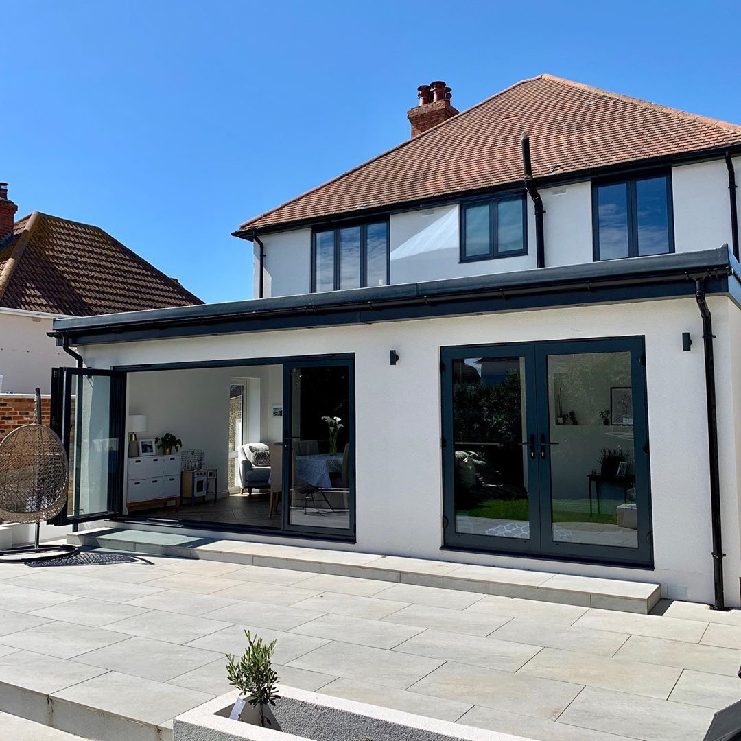 White rendered single storey rear extension