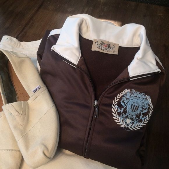 Juicy Couture chocolate brown nylon zip top Totally cute Juicy Couture nylon zip up top. Perfect for Spring. 2 cream stripes down each arm and the sides. It's a medium but very fitted. No flaws or defects. Juicy Couture Tops