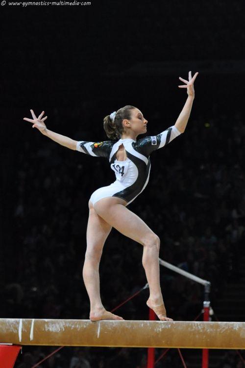 gymnast performing on balance beam gymnastics