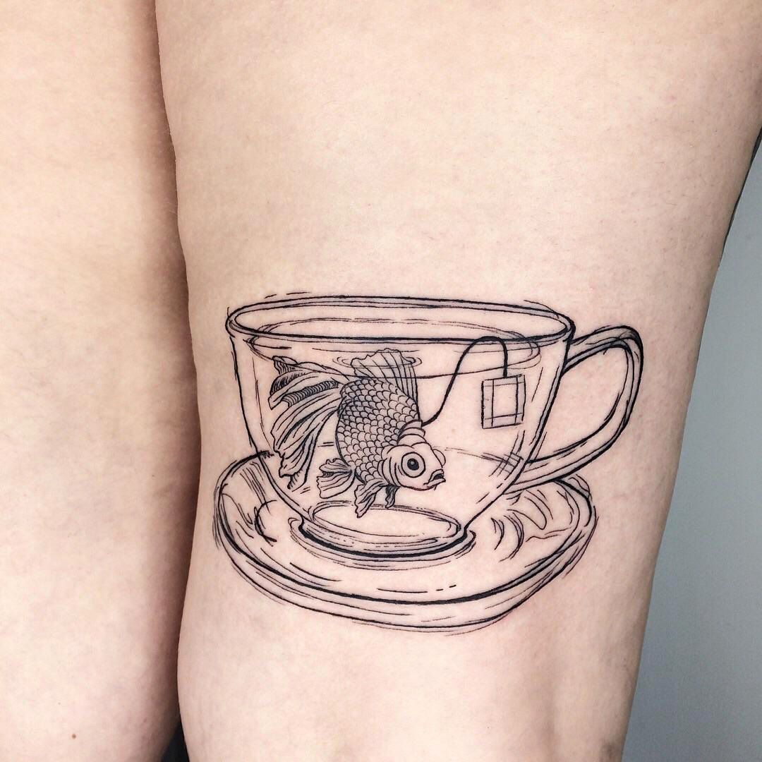 Sweet Little Fishy In A Teacup By Bailey Jork At Rat Tat Studio In Indianapolis In Evamigtattoos Tattoos Teacup Tattoo Pretty Tattoos